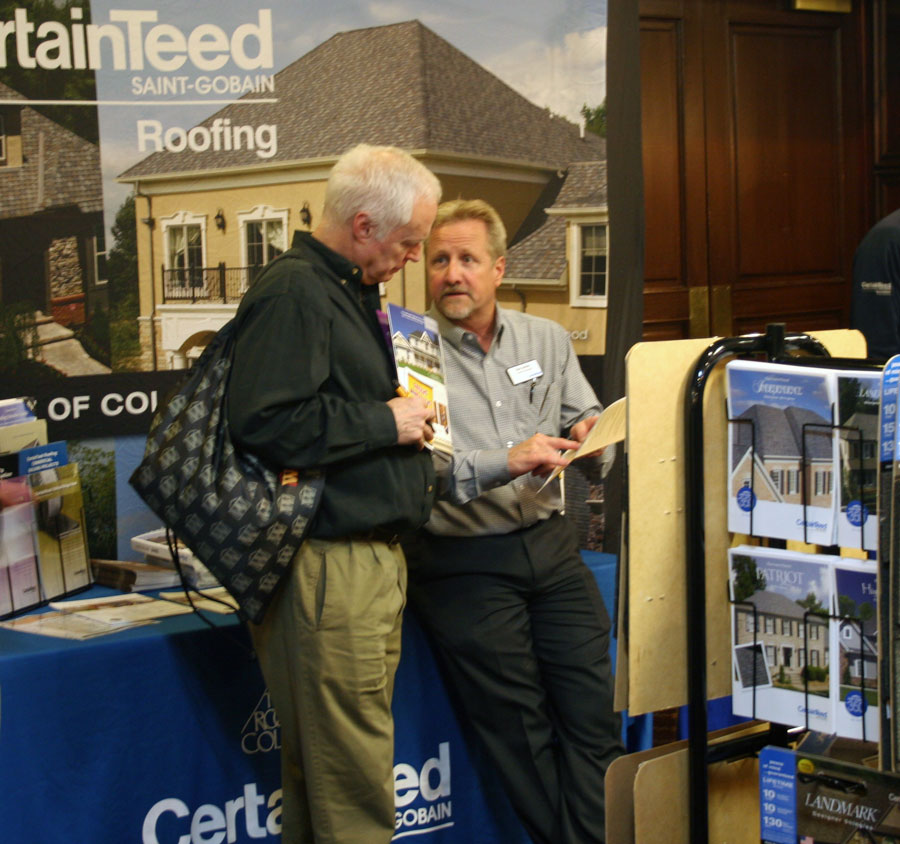 Dan Zernec discusses CertainTeed shingles with a customer at the Wimsatt Spring Show