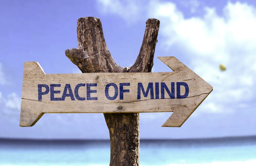 Peace of Mind wooden sign with a beach on background.jpeg