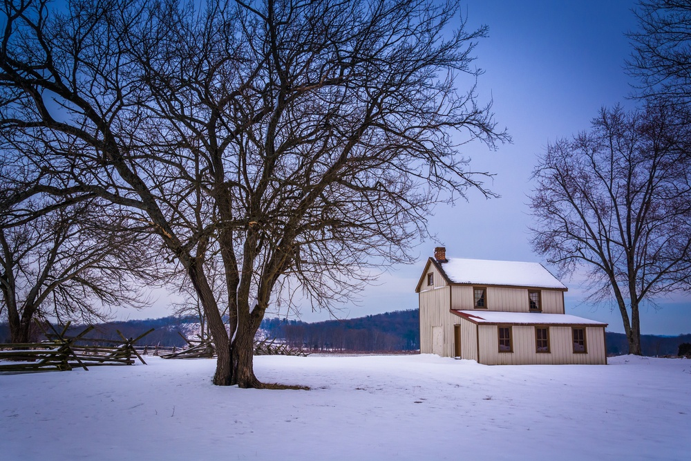 Small house and trees in a snow-covered field in Gettysburg, Pennsylvania..jpeg