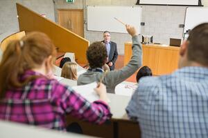 Students with a teacher at the college lecture hall